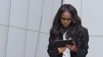 Young businesswoman using digital tablet outdoors video