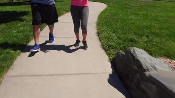 Couple running at park video