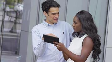 Businessman and businesswoman using digital tablet video
