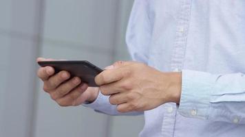 Closeup shot of businessman using digital tablet video