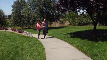 Athletic couple running at park video