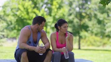 Couple at park take a water break video