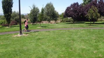Aerial shot of couple running at park video