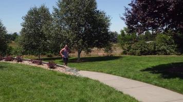 Athletic man running at park video