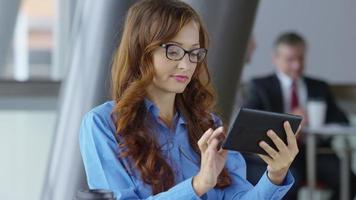 Young businesswoman using digital tablet video