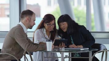 Group of business people using digital tablet video