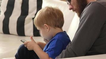 Father and Son using digital tablet together video
