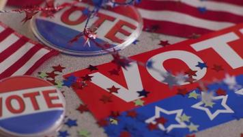 VOTE banners, buttons and confetti, election concept video