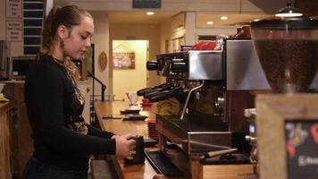 Woman working at a coffee shop video