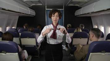 Airliner flight attendant explaining safety rules video