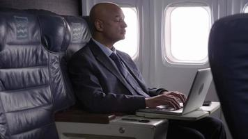 Business people working on airplane flight video