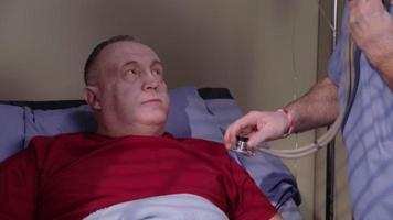 Senior man is examined in hospital video