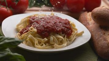 Parmesan cheese sprinkled onto pasta in super slow motion, shot on Phantom Flex 4K video