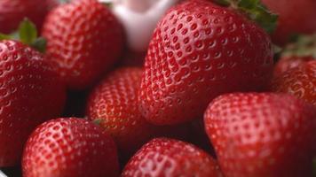 Pouring yogurt onto strawberries in super slow motion, shot on Phantom Flex 4K video