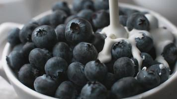Pouring cream onto blueberries in super slow motion, shot on Phantom Flex 4K video