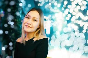 Portrait of beautiful blonde girl in black dress photo