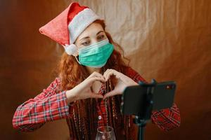 Christmas video call with love symbol by hands photo