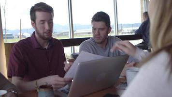 Group of young business people working together in casual workspace video