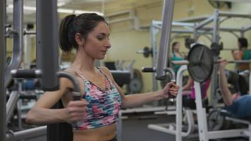 Young woman working out at gym video