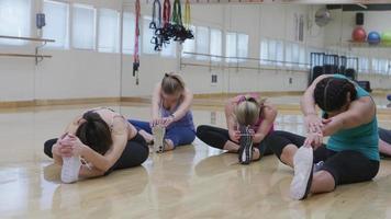 People stretching in yoga studio video