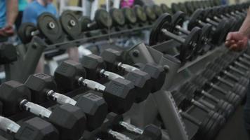 Muscular man picks up weights at gym video