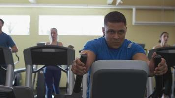 Man working out hard on stair machine at gym video