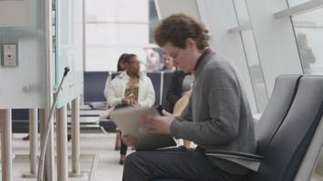 Man using laptop at airport video
