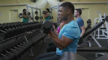 People lifting weights at gym video