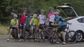 Group of cyclists pose for group photo.  Fully released for commercial use. video