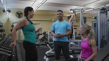 Group of people talking together at gym video