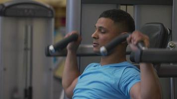Man lifting weights at gym video