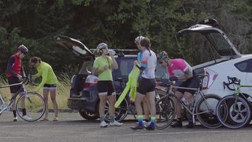 Group of cyclists taking break and preparing for ride.  Fully released for commercial use. video