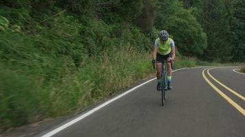 Tracking shot of a female cyclist on country road.  Fully released for commercial use. video