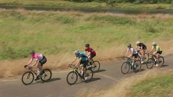 Group of cyclists on scenic country road.  Fully released for commercial use. video