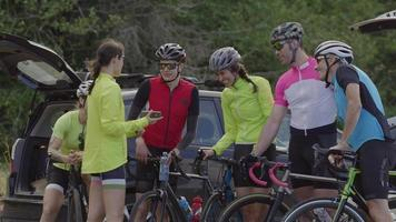 Group of cyclists look at photo on phone together.  Fully released for commercial use. video