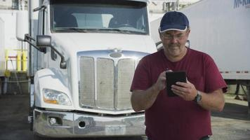 Truck driver using digital tablet.  Fully released for commercial use. video
