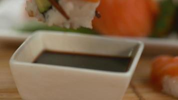 Closeup dipping sushi into soy sauce in super slow motion, shot with Phantom Flex 4K video