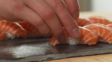 Chef places sushi onto tray video