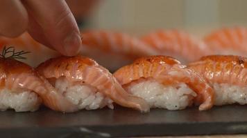 Chef adds garnish to sushi video