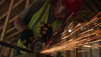 Construction worker grinding metal and making sparks video