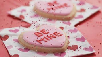 Valentine's Day heart shaped cookies with sprinkles pouring. Shot on Phantom Flex 4K. video