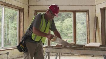 Construction worker cutting board with hand saw video