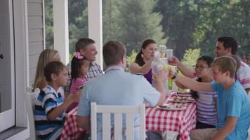 Group of people eating and enjoying a backyard barbeque video