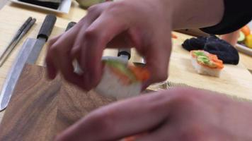 Chef placing sushi onto tray video