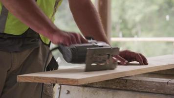Closeup of construction worker using jigsaw video