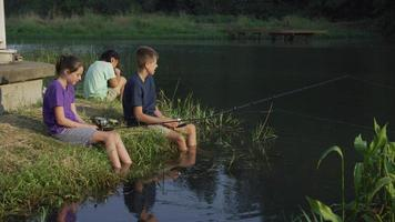 Kids at summer camp fishing in pond video