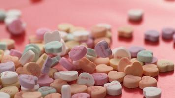 Valentine's Day heart shaped candy falling and bouncing in slow motion. Shot on Phantom Flex 4K. video