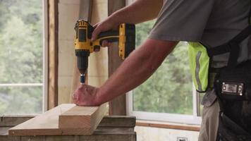 Construction worker using cordless screw gun video
