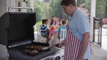 Man cooking with grill at backyard barbeque video