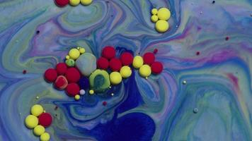 Abstract close up texture of oil with blue, red and yellow paint video